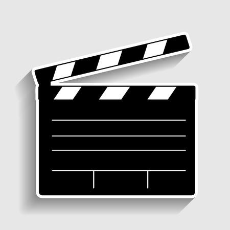 Film clap board cinema ondertekenen. Sticker stijlicoon met schaduw op grijs.