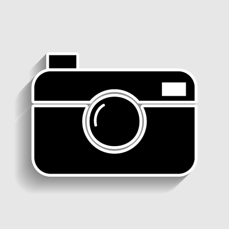 whim: Digital photo camera icon. Sticker style icon with shadow on gray.