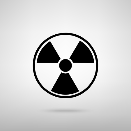 environmental hazard: Radiation Round sign. Black with shadow on gray.