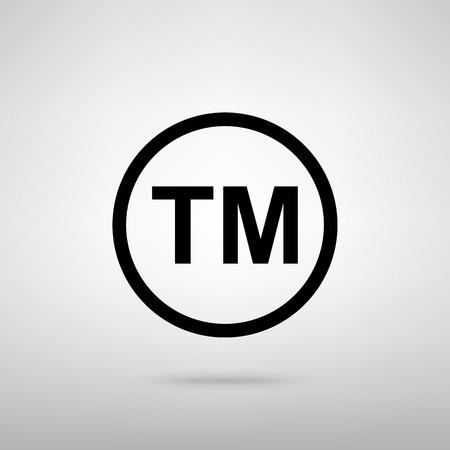 trade mark: Trade mark sign. Black with shadow on gray.