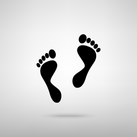 alibi: Foot prints sign. Black with shadow on gray.
