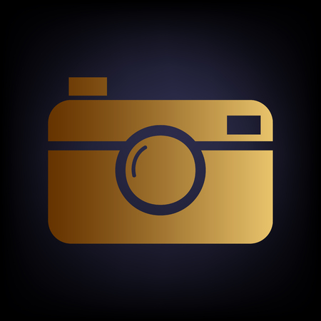 whim of fashion: Digital photo camera icon. Golden style icon on dark blue background.