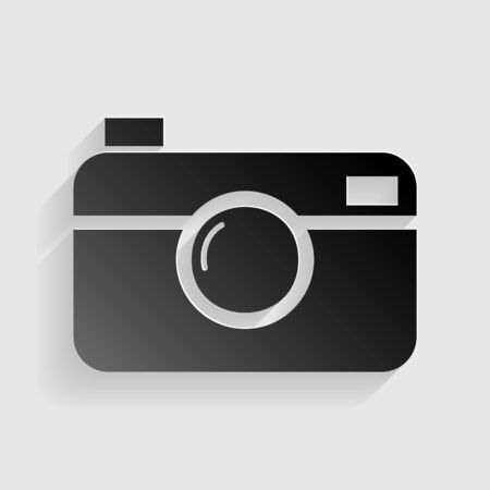 Digital photo camera sign. Black paper with shadow on gray background.