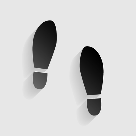 shoeprint: Imprint soles shoes sign. Black paper with shadow on gray background.
