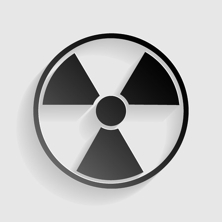 radiological: Radiation Round sign. Black paper with shadow on gray background.