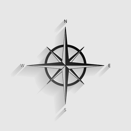 Wind rose sign. Black paper with shadow on gray background.