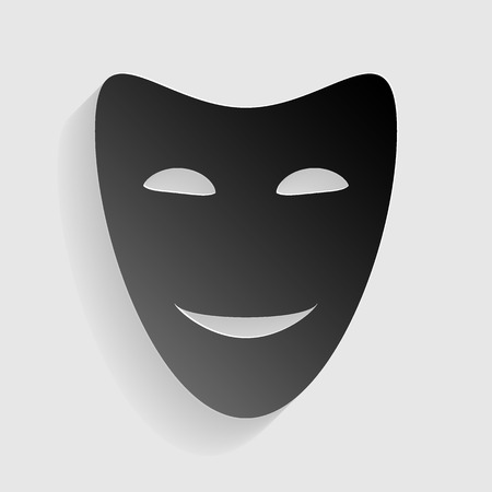 comedy: Comedy theatrical masks. Black paper with shadow on gray background.