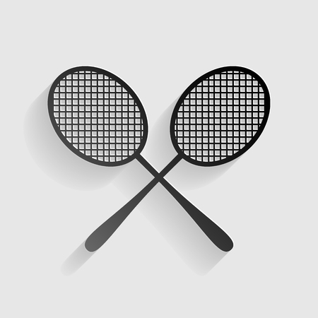 Tennis racquets sign. Black paper with shadow on gray background.