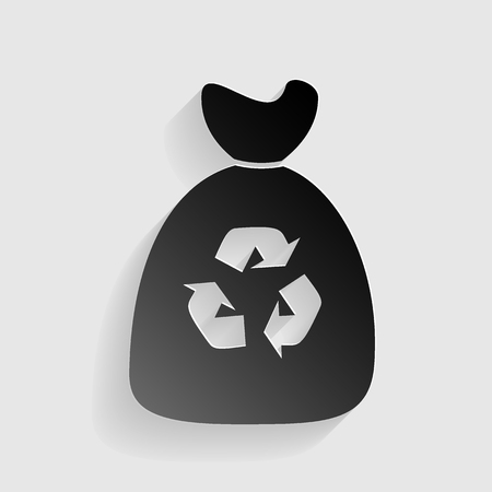 Trash bag icon. Black paper with shadow on gray background.