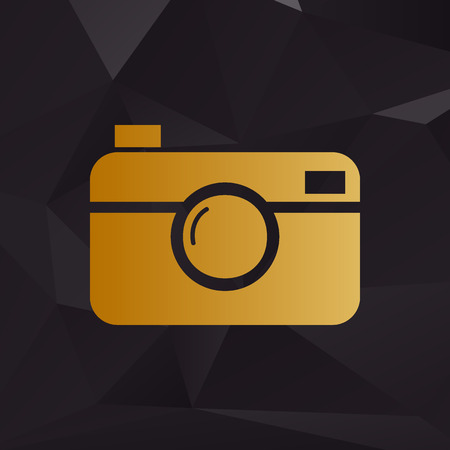 Digital photo camera sign. Golden style on background with polygons.