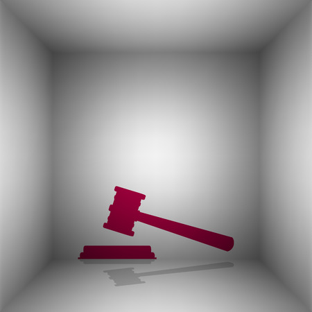 Justice hammer sign. Bordo icon with shadow in the room.