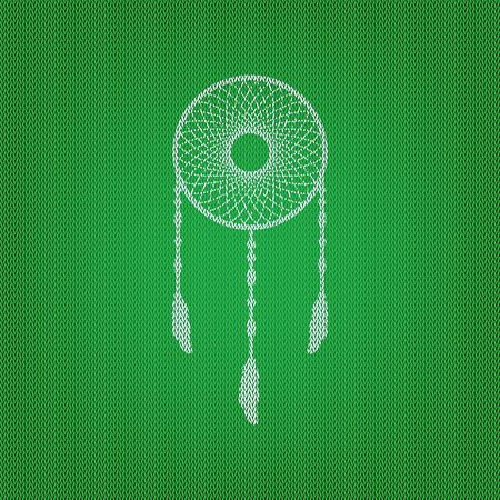 swelled: Dream catcher sign. white icon on the green knitwear or woolen cloth texture.