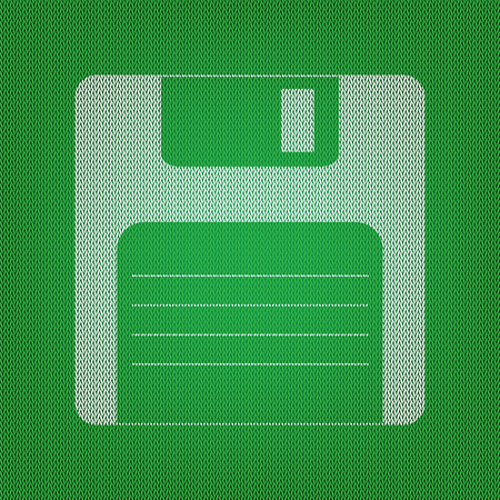 Floppy disk sign. white icon on the green knitwear or woolen cloth texture.