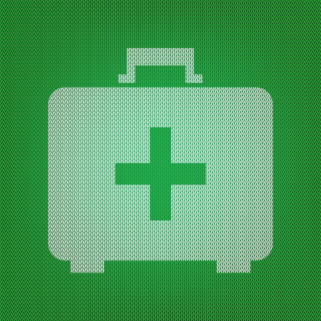 Medical First aid box sign. white icon on the green knitwear or woolen cloth texture. Illustration