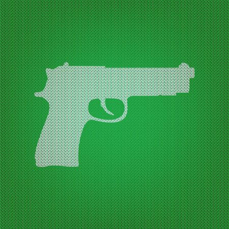 Gun sign illustration. white icon on the green knitwear or woolen cloth texture.