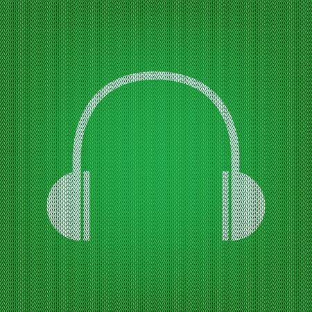 Headphones sign illustration. white icon on the green knitwear or woolen cloth texture.