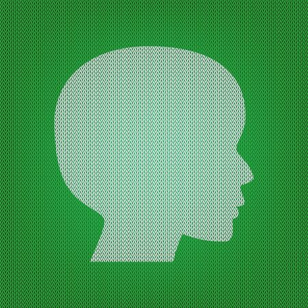 People head sign. white icon on the green knitwear or woolen cloth texture.