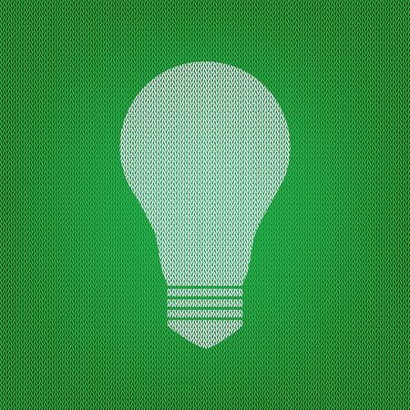 Light lamp sign. white icon on the green knitwear or woolen cloth texture.