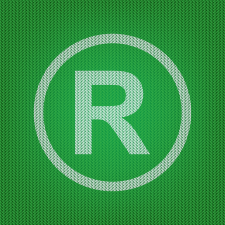 Registered Trademark sign. white icon on the green knitwear or woolen cloth texture.