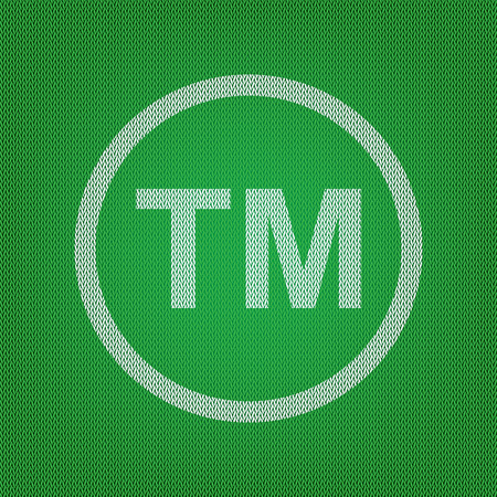 Trade mark sign. white icon on the green knitwear or woolen cloth texture. Illustration