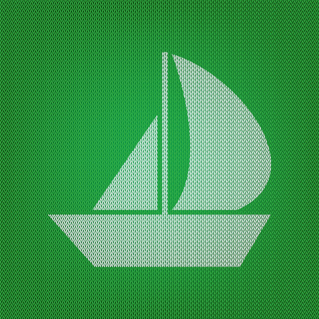 Sail Boat sign. white icon on the green knitwear or woolen cloth texture.