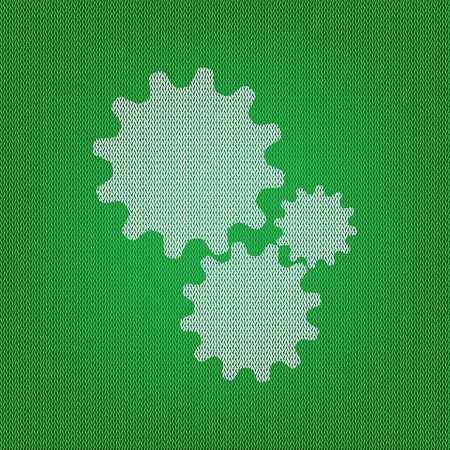 Settings sign illustration. white icon on the green knitwear or woolen cloth texture.
