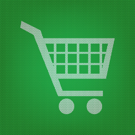Shopping cart sign. white icon on the green knitwear or woolen cloth texture. Illustration