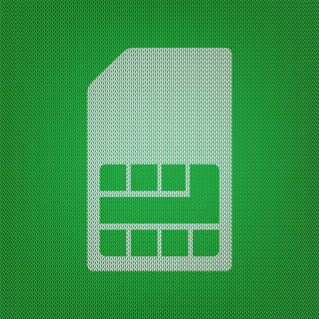Sim card sign. white icon on the green knitwear or woolen cloth texture.