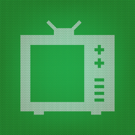TV sign illustration. white icon on the green knitwear or woolen cloth texture.