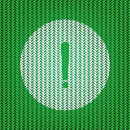 Exclamation mark sign. white icon on the green knitwear or woolen cloth texture.