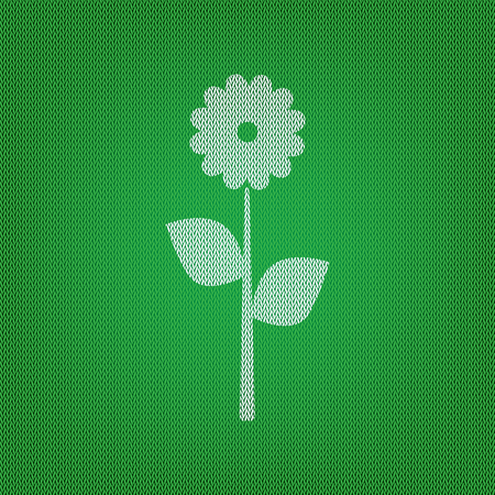 Flower sign illustration. white icon on the green knitwear or woolen cloth texture.