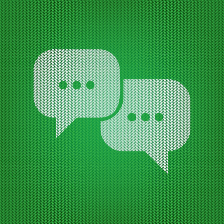Speech bubbles sign. white icon on the green knitwear or woolen cloth texture. Illustration