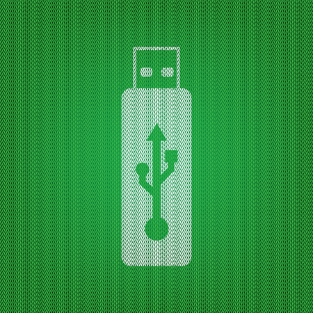 Vector USB flash drive sign. white icon on the green knitwear or woolen cloth texture. Illustration