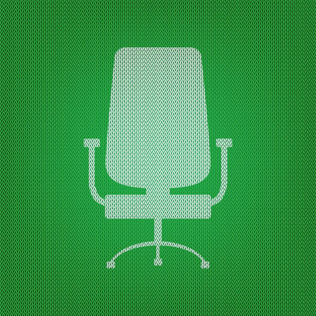 Office chair sign. white icon on the green knitwear or woolen cloth texture.