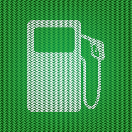Gas pump sign. white icon on the green knitwear or woolen cloth texture. Illustration