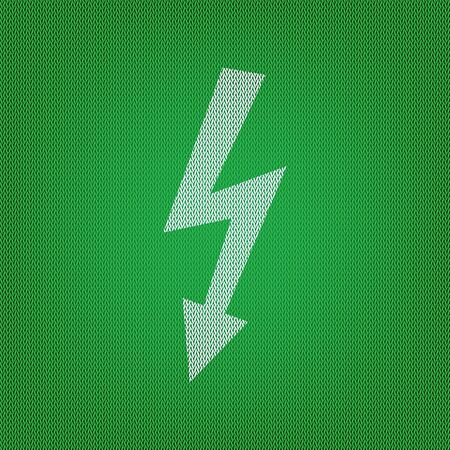 voltage sign: High voltage danger sign. white icon on the green knitwear or woolen cloth texture. Illustration