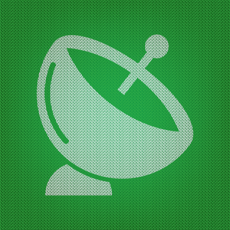 Satellite dish sign. white icon on the green knitwear or woolen cloth texture.