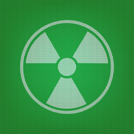 Radiation Round sign. white icon on the green knitwear or woolen cloth texture.