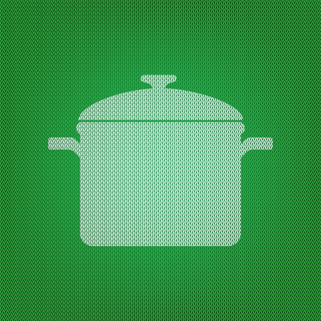 Cooking pan sign. white icon on the green knitwear or woolen cloth texture.