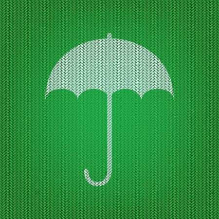 Umbrella sign icon. Rain protection symbol. Flat design style. white icon on the green knitwear or woolen cloth texture.