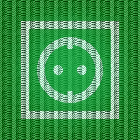 Electrical socket sign. white icon on the green knitwear or woolen cloth texture.