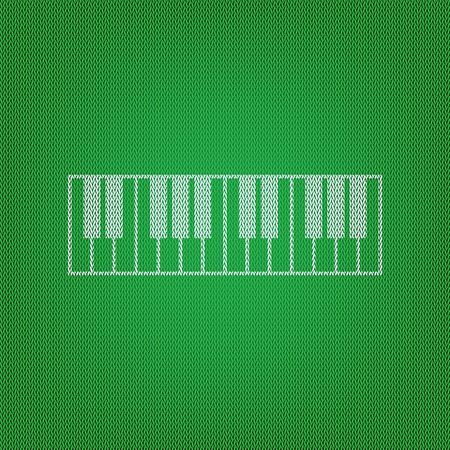 Piano Keyboard sign. white icon on the green knitwear or woolen cloth texture.