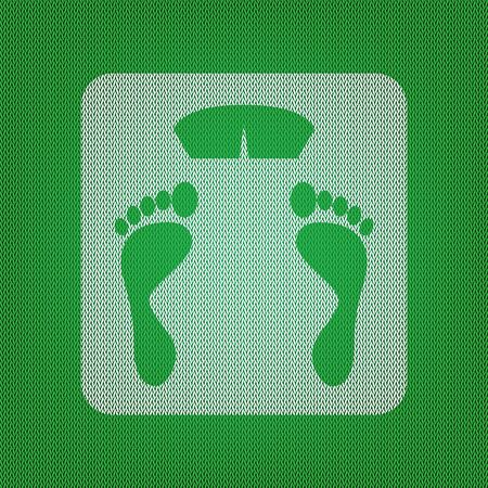 Bathroom scale sign. white icon on the green knitwear or woolen cloth texture.
