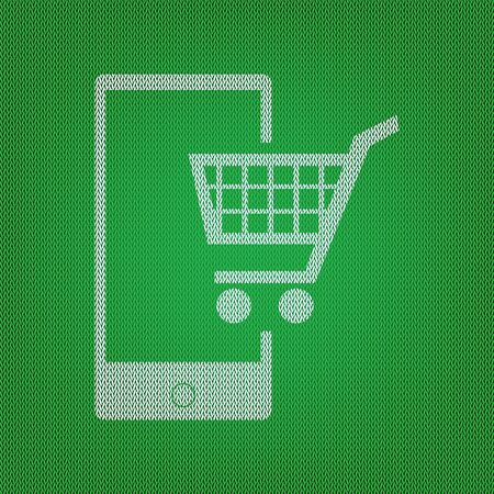 retail equipment: Shopping on smart phone sign. white icon on the green knitwear or woolen cloth texture.