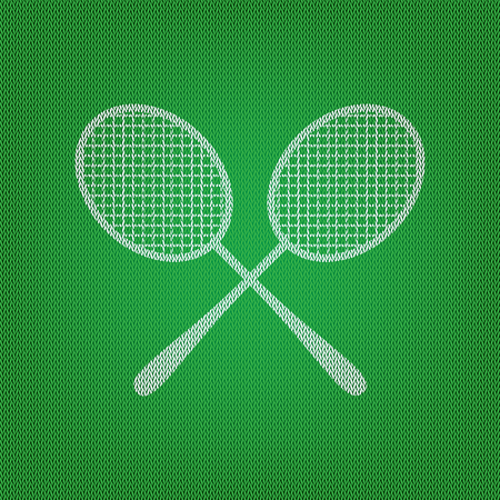 Tennis racquets sign. white icon on the green knitwear or woolen cloth texture.