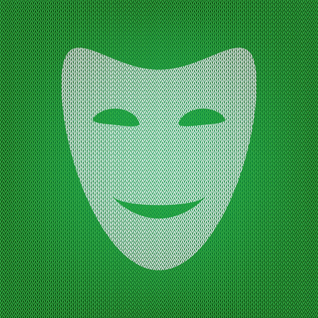 Comedy theatrical masks. white icon on the green knitwear or woolen cloth texture.