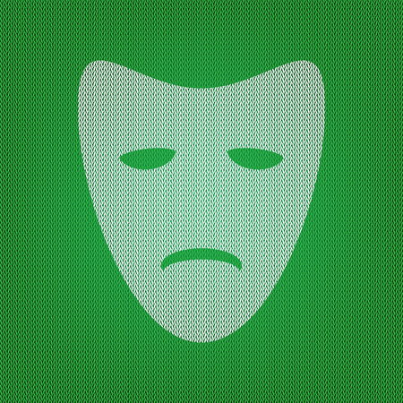 Tragedy theatrical masks. white icon on the green knitwear or woolen cloth texture.