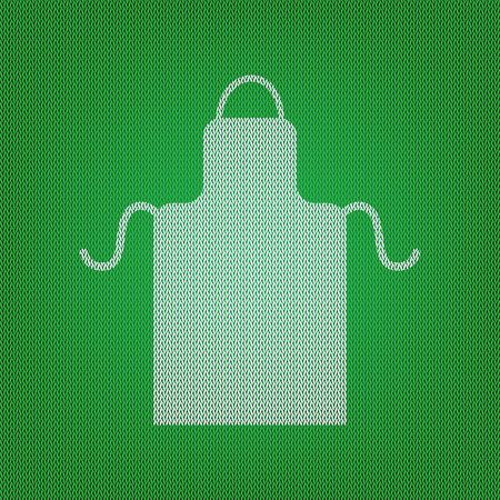 Apron simple sign. white icon on the green knitwear or woolen cloth texture.