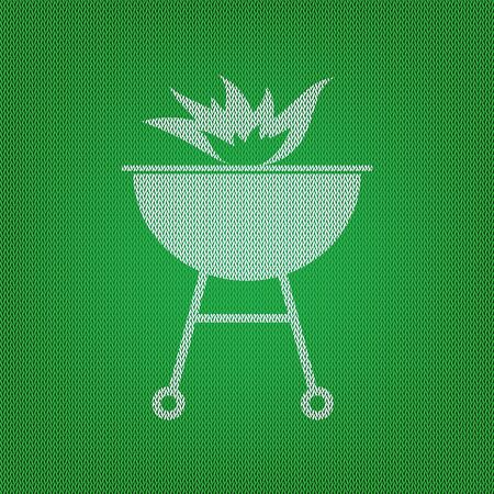 Barbecue with fire sign. white icon on the green knitwear or woolen cloth texture.