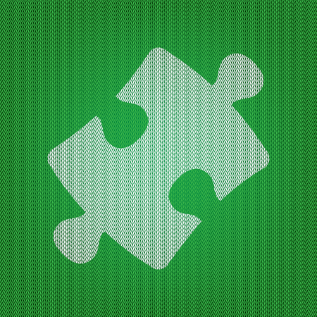 Puzzle piece sign. white icon on the green knitwear or woolen cloth texture.